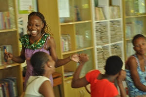 Kenyan students celebrating a job well done after learning how to role-play for the first time.